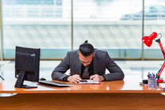 The sad businessman sitting in the office Royalty Free Stock Photo