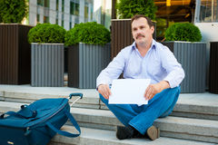 Sad businessman sitting on the steps Stock Image
