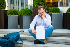 Sad businessman sitting on the steps Royalty Free Stock Photo