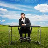Sad businessman sitting at table Royalty Free Stock Photography