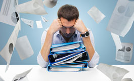 Sad businessman with stack of folders at office. Business, people, deadline, stress and paperwork concept - sad businessman with stack of folders and falling Royalty Free Stock Photography