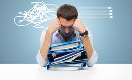 Sad businessman with stack of folders at office Stock Image