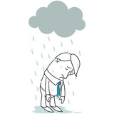 Sad businessman standing in the rain Royalty Free Stock Photos