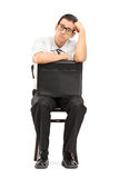 Sad businessman with suitcase waiting for job interview Stock Image