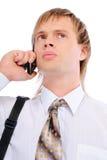 Sad businessman talks on cellular telephone Stock Photography