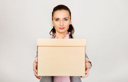 Sad businesswoman carrying box. Stock Images
