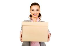 Sad businesswoman carrying box. Stock Photos