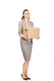 Sad businesswoman carrying box. Stock Photos