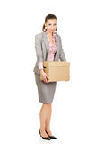 Sad businesswoman carrying box. Royalty Free Stock Photo