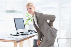 Sad businesswoman having back pain Stock Photos