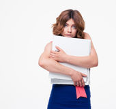 Sad businesswoman holding folders Royalty Free Stock Photos