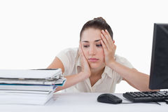 Sad businesswoman leaning on her desk Royalty Free Stock Photo