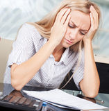 Sad businesswoman looks at the documents Royalty Free Stock Photo