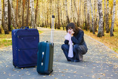 Sad businesswoman with a luggage. Royalty Free Stock Images
