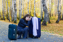 Sad businesswoman with a luggage. Royalty Free Stock Photos