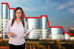 Sad businesswoman and office building Stock Photo