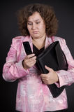 Sad businesswoman reading sms Royalty Free Stock Images