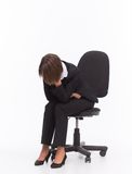 Sad businesswoman sit on chair Stock Photos
