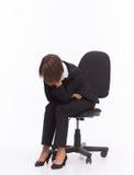 Sad businesswoman sit on chair Stock Photos