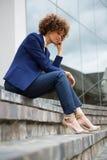 Sad businesswoman sitting in the premises. Sad businesswoman sitting in the office premises Stock Photography
