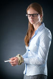 Sad Businesswoman Tied Up in Credit Debt Stock Image