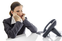 Sad businesswoman waiting for a phone call Stock Image
