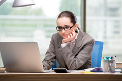 The sad businesswoman working at her desk Stock Photography
