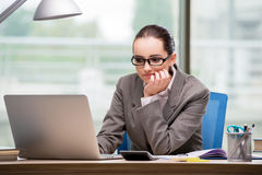 The sad businesswoman working at her desk Stock Photos
