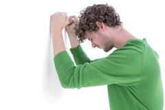 Sad casual man leaning against wall Royalty Free Stock Image