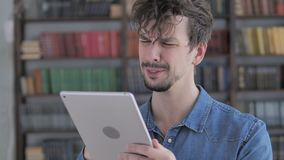 Sad Casual Young Man in Awe for Losing Online on Tablet. The Sad Casual Young Man in Awe for Losing Online on Tablet, high quality stock video footage