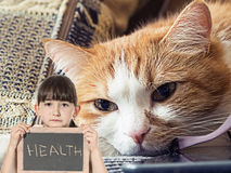 Sad cat and girl with chalkboard Royalty Free Stock Photography