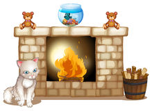 A sad cat near the fireplace Royalty Free Stock Photos