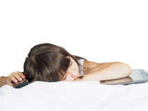Sad caucasian child kid girl sister lying on the bed with mobile phone and tablet pc isolated Stock Photography