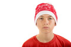 Sad teenage boy wearing a Christmas hat Stock Images