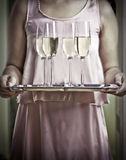 Sad champagne. Sad picture of champagne on silver tray Royalty Free Stock Photos