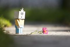 Sad character. An image of a handmade sad character and a flower royalty free stock photo