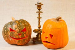 Sad and cheerful halloween pumpkin with candle Stock Photo