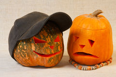 The sad and cheerful halloween pumpkins. The sad and cheerful halloween pumpkin from canvas background Royalty Free Stock Images