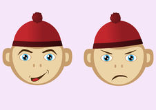 Sad and cheerful muzzle monkey wearing a hat. Royalty Free Stock Photo