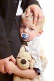 Sad child. Sad infant hugging his mother Royalty Free Stock Photo
