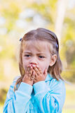 Sad Child. Little girl with hands over mouth and a look of shock or sadness Royalty Free Stock Photography