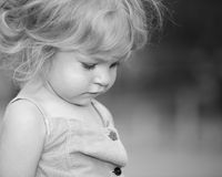 Sad child. Cute child sadly looking down royalty free stock photo