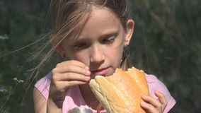 Sad Child in Abandoned House Depressed Stray Girl, Homeless Kid Eating Bread stock image