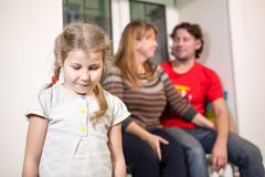 Sad child on background of happy parents, new dad in family Royalty Free Stock Image