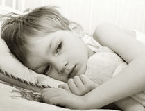 Sad child in bed Royalty Free Stock Photos