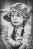 Sad child, black-white, sufferingLittle girl with fear in the face. A little girl with a look of fear and despair looking in front of myself Stock Images