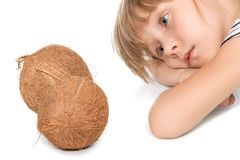 Sad child and coconuts Stock Photography