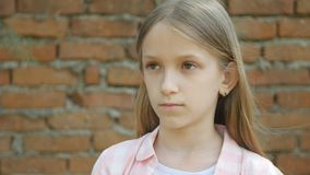 Sad child expression, unhappy girl portrait, depressed bored kid face.  stock video