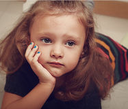 Sad child girl thinking about. Closeup Stock Photo