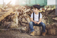 Sad child. With hat on the field Royalty Free Stock Photos